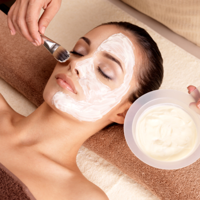 Spa therapy for woman receiving facial maskSpa therapy for woman receiving facial mask